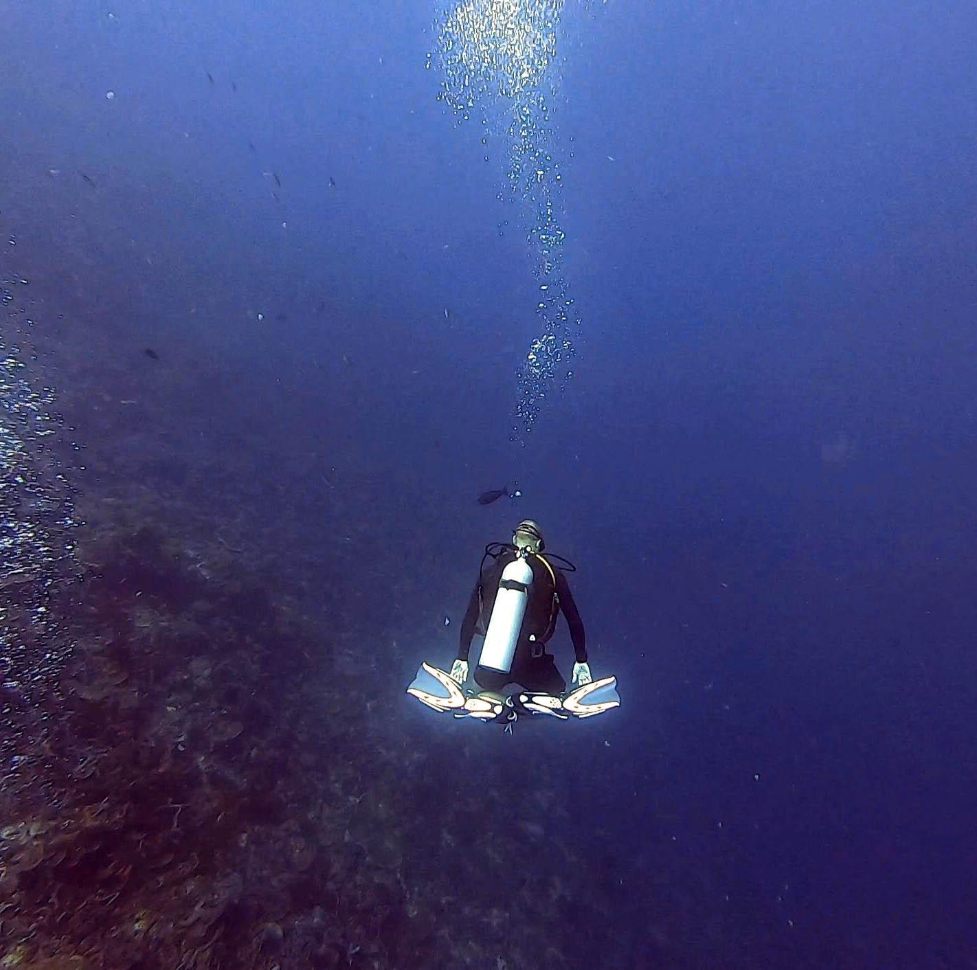 diver floating in meditation pose
